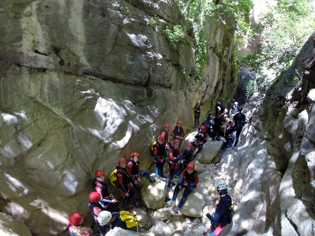 Suited up and ready to go, our group awaits its first rappel while canyoning in Grazalema's Garganta Verde.